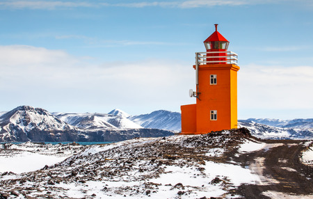 Yellow lighthouse located near the fishing town Grindavik on the south west coast of Iceland. Stock Photo