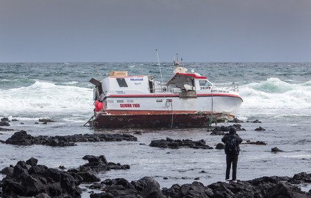 Grindavik, Iceland  May 14, 2015 : Commercial fishing boat  stranded at the rocky shore at the southwest part of Iceland.