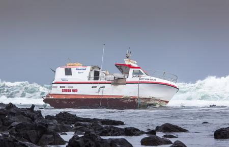 grindavik: Grindavik, Iceland  May 14, 2015 : Commercial fishing boat  stranded at the rocky shore at the southwest part of Iceland.