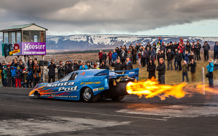 explosion engine: Iceland - June 7, 2015 : Fire Fox 3 funny jet car at drag racing event in Iceland. Editorial