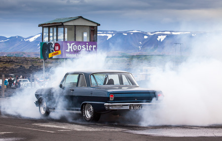 Iceland - July 11, 2015 : 1964 Chevrolet Nova burnout at drag racing event in Iceland. Editorial