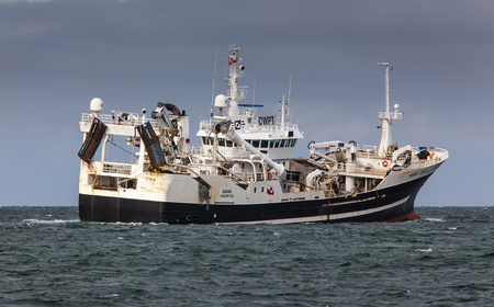 Iceland - August 9, 2015 : Pelagic fishing vessel Qavak GR 2-1 with home port in Greenland sailing in Icelandic waters. Editorial