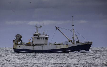 Iceland - April 28.2016 : Old commercial fishing boat sailing on the north Atlantic ocean. Editorial