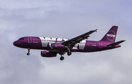 approaches: Iceland - April 17, 2016 : Airbus A320-232 from WOW Air approaches KEF international airport in Iceland.