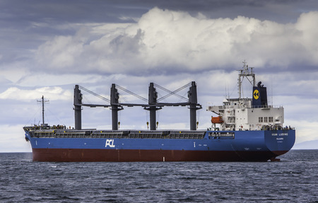 cargo vessel: Iceland - July 11, 2016 : Cargo vessel Ikan Lunding sailing in Icelandic waters.