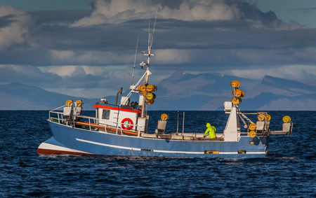 Fishing boat on mackerel fishing near the southwest coast of Iceland. Stock Photo