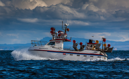 Iceland - August 28, 2016 : Fishing boat on mackerel fishing near the southwest coast of Iceland.