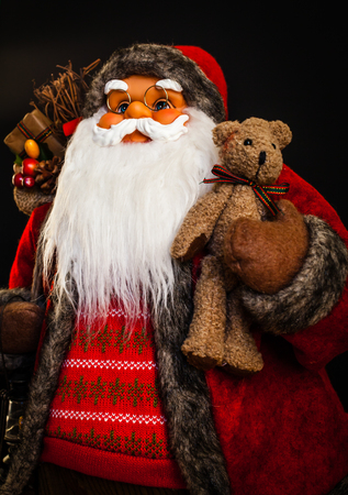 Portrait of a Santa Claus doll with black background. Stock Photo