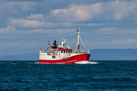 Old commercial fishing boat sailing in Icelandic waters.