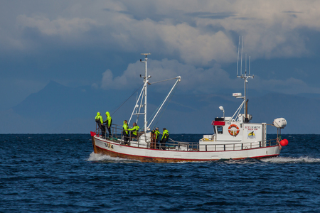Iceland - August 12, 2017 : Old whale watching boat 1153 Margrét SU-4 looking out for whales in Icelandic waters.