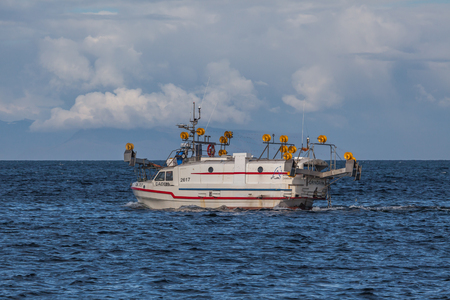 Iceland - August 12, 2017 : Commercial fishing boat 2799 Daðey GK-77 at mackerel fishing in Icelandic waters. Editorial