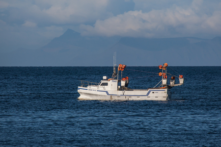 Iceland - August 12, 2017 : Commercial fishing boat 7040 Eiður ÓF-13 at mackerel fishing in Icelandic waters. Editorial