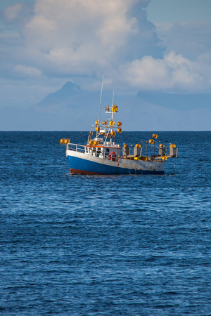 Iceland - August 11, 2017 : Commercial fishing boat 1511 Ragnar Alfreðs GK-183 at mackerel fishing in Icelandic waters.