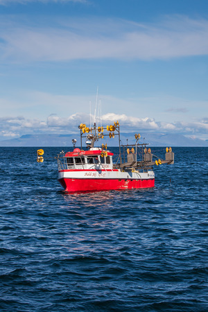 Iceland - August 11, 2017 : Commercial fishing boat 2106 Addi Afi GK-97 at mackerel fishing in Icelandic waters.