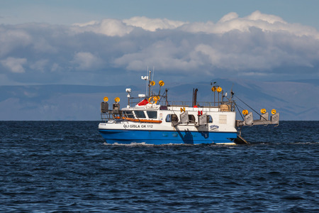 Iceland - August 11, 2017 : Commercial fishing boat 2714 Óli Gísla GK-112 at mackerel fishing in Icelandic waters.