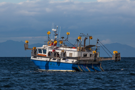 Iceland - August 11, 2017 : Commercial fishing boat 2714 Óli Gísla GK-112 at mackerel fishing in Icelandic waters.