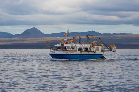 Iceland - August 16, 2017 : Commercial fishing boat 2714 Óli Gísla GK-112 at mackerel fishing in Icelandic waters. Editorial