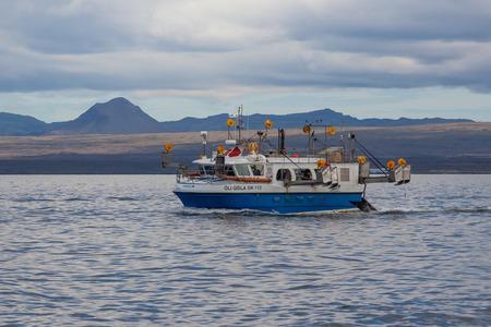 Iceland - August 16, 2017 : Commercial fishing boat 2714 Óli Gísla GK-112 at mackerel fishing in Icelandic waters. Editorial