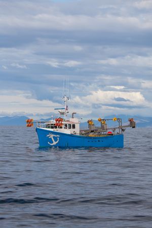 Iceland - August 16, 2017 : Commercial fishing boat 1852 Agnar BA-125 at mackerel fishing in Icelandic waters.