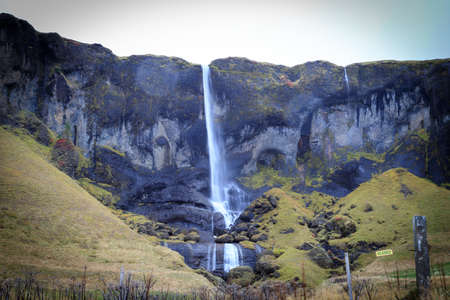 Long exposure photo of waterfall, view of the small waterfall in Westfjords of Iceland, Europe. Stock Photo