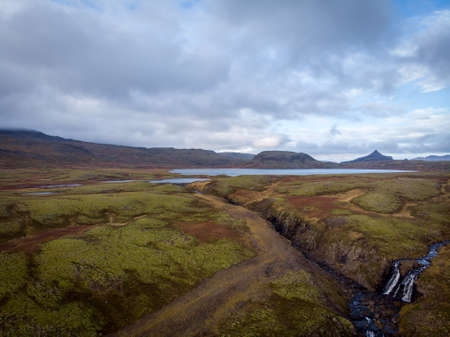 Iceland. Aerial view on the mountain, field, bridge and river. Landscape in the Iceland at the day time. Landscape from drone. Travel - image