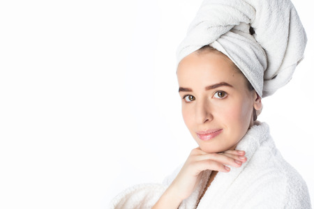 towel head: Beautiful young woman in bathrobe and towel on her head and light makeup, studio portrait