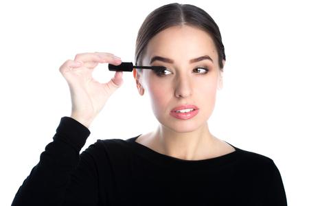 applied: beautiful young woman applied mascara