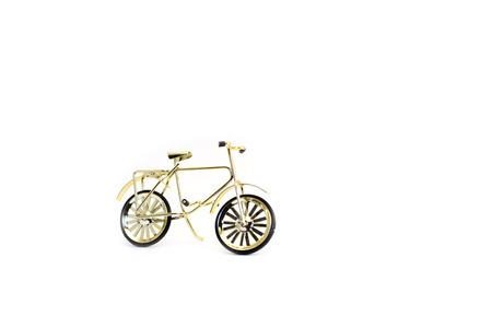 Toy gold bicycle. Isolated on white background. Stock Photo