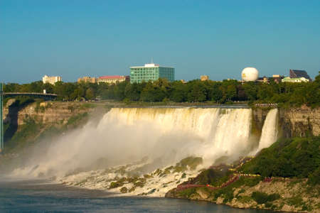 The falls with city skyline in the background photo