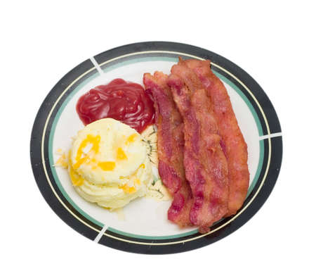 Breakfast meal of bacon and eggs isolated on a white background