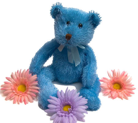 Isolated Blue Teddy Bear with flowers on a white background