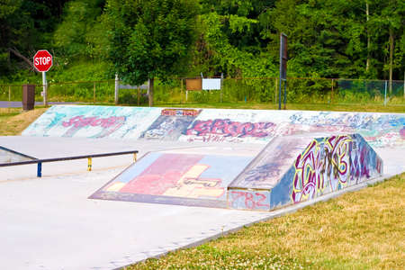 asbo: Grunge and Graffiti spary painted on concrete in a skate park Editorial
