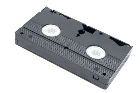 superseded: An obsolete black video tape isolated on a white background