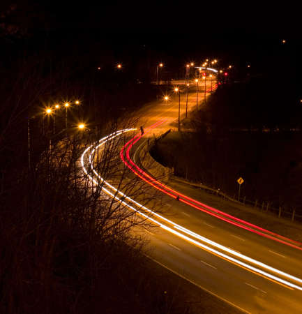 that: Night traffic with nice light streaks that follow the cars. Stock Photo
