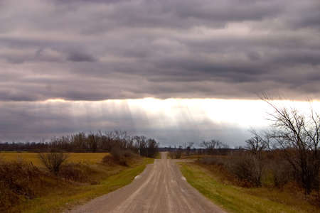 Sun rays on a country road in Canada. photo