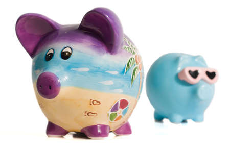 Two isolated piggy banks on a white background Stock Photo