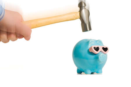 Piggy bank about to get smahed with a hammer Stock Photo
