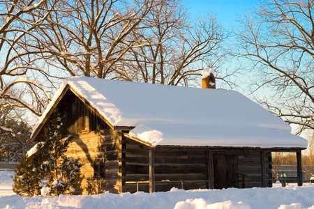 log cabin: Snow covered cabin in Canada.