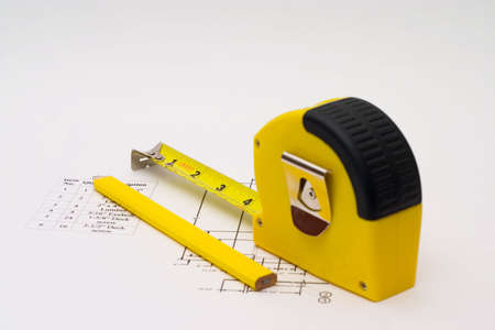 budget repair: Measuring tape to help illustrate construction projects Stock Photo