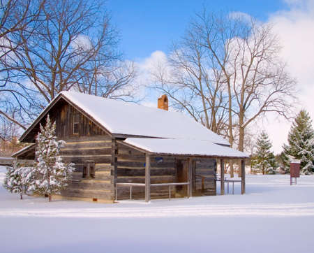 log cabin: Snowy Cabin With Blue Sky Stock Photo