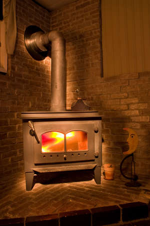 Cozy Little fireplace in a corner ready to warm up Stock Photo - 3592862