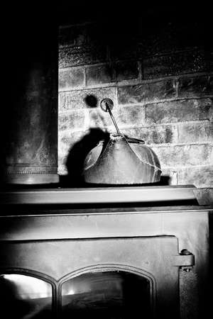 Water Kettle on a warm fireplace in a corner Stock Photo - 3593033