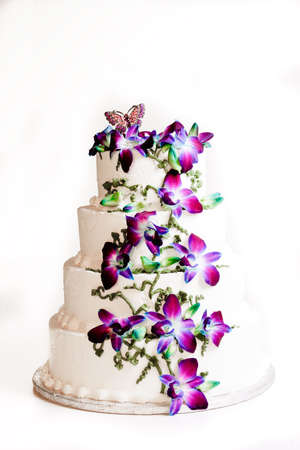 Four tier wedding cake with purple flowers Stock Photo