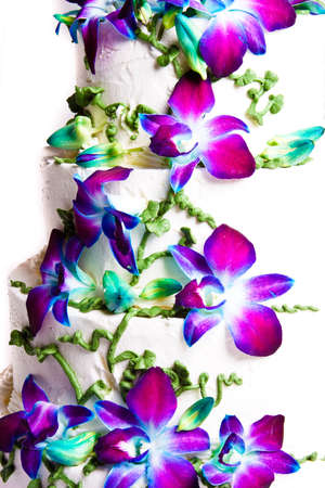 tier: Four tier wedding cake with purple flowers Stock Photo