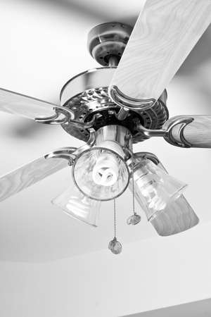 airflow: Ceiling Fan attached to the roof of a room