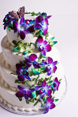 layer cake: Four tier wedding cake with purple flowers Stock Photo