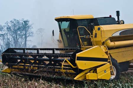 Agriculture - Combine harvesting farm land photo