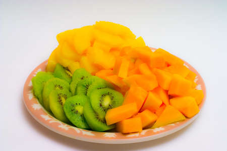 Isolated tray of Kiwi, Pineapple and cantaloupe 스톡 콘텐츠