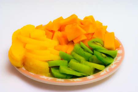 Isolated tray of Kiwi, Pineapple and cantaloupe Stock Photo - 4299581