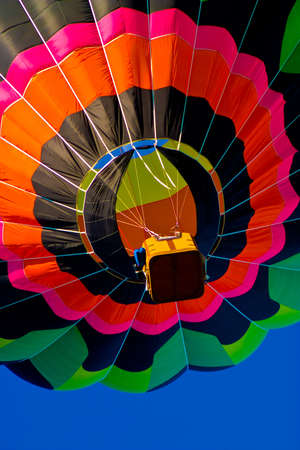 hot air ballon: Colorful hot air balloon travelling to the sky